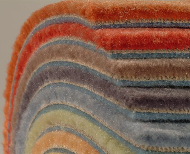 stack of colorful carpets